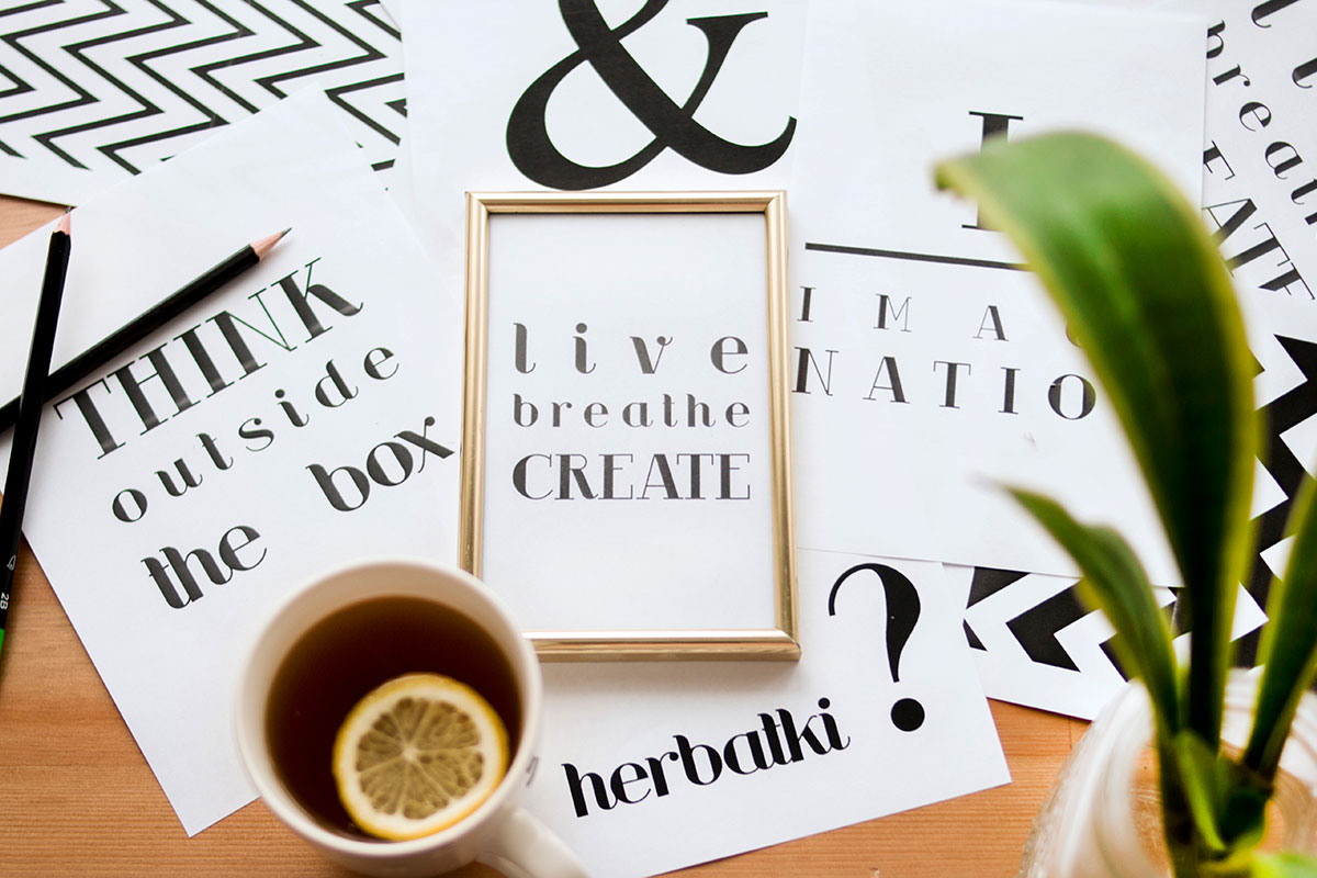 Canva - Quote Calligraphy Under Cup of Lemon Tea